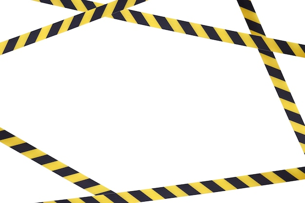 Black and yellow lines of barrier tape prohibit passage.