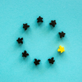 Black and yellow meeple board game pieces