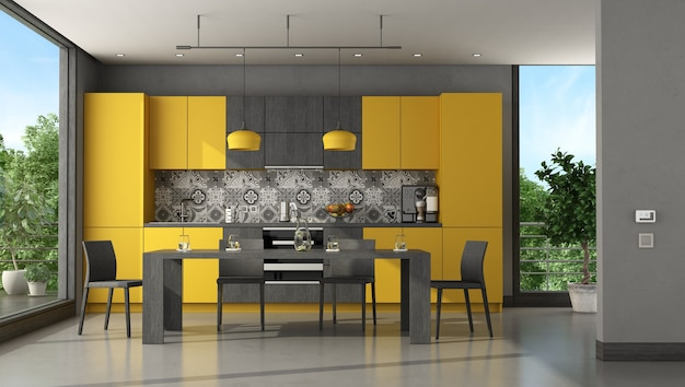 Black and yellow modern kitchen with dining table and chair