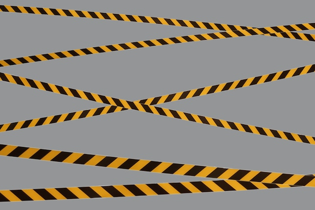 Black and yellow warning lines of barrier tape prohibit passage. barrier on gray isolated. cross that prohibits traffic. danger unsafe area warning do not enter. concept no entry. copy space