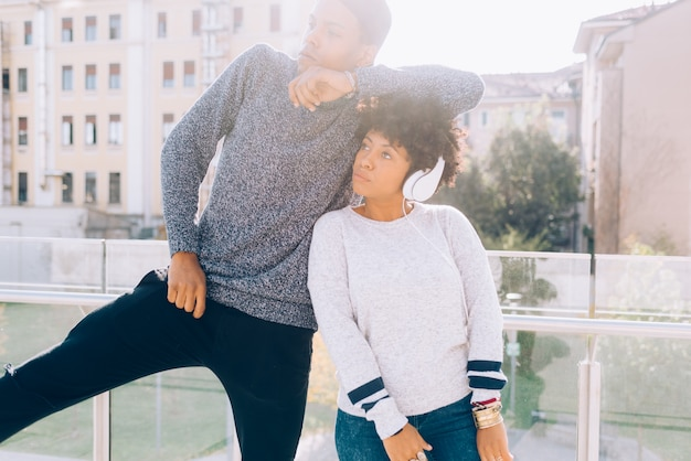 Black young couple having fun and listening to music