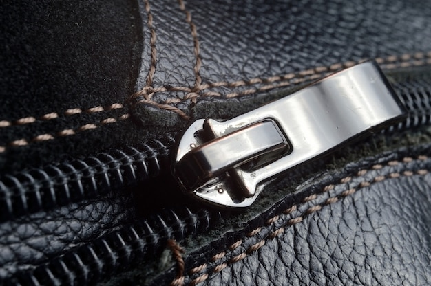 Black zipper on black leather boots..