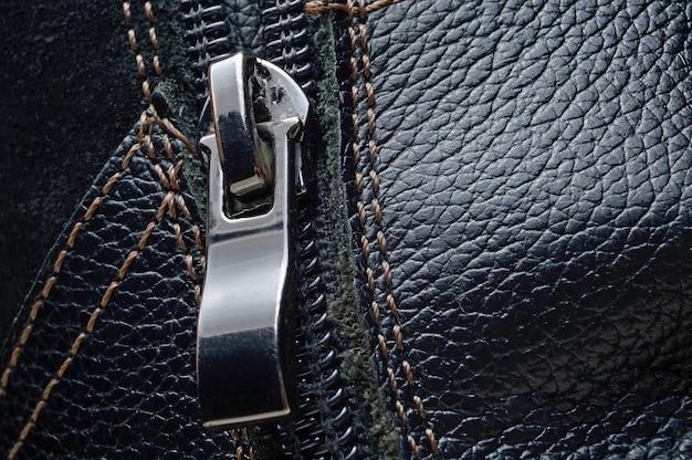 Black zipper on black leather boots
