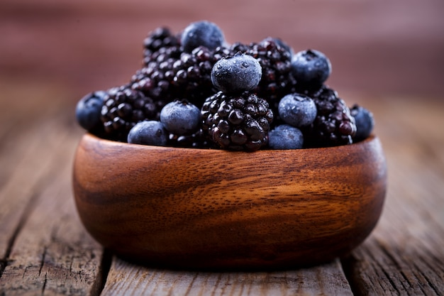 Blackberry and blueberry in a wooden bowl