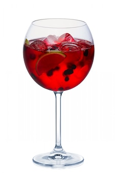 Blackberry cocktail with a sparkling wine, lime and ice cubes in round wine glass isolated on white