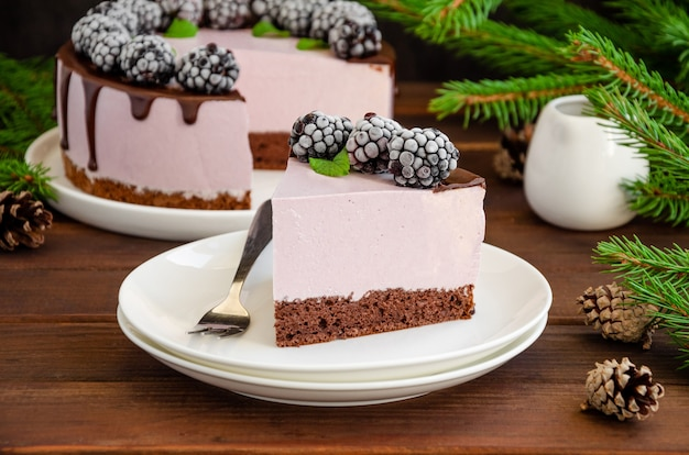 Blackberry cream mousse cake with chocolate glaze