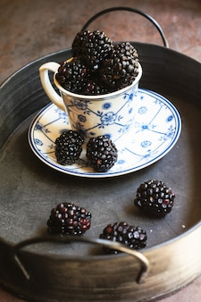 Blackberry fruits in the cup