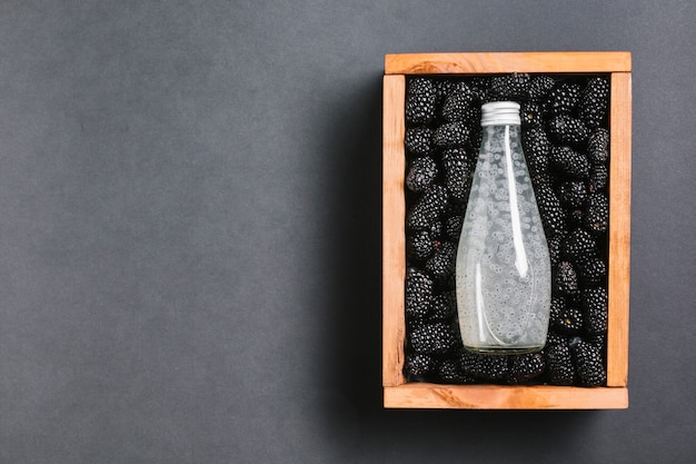 Blackberry juice bottle on wooden box