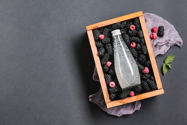 Blackberry juice bottle on wooden box