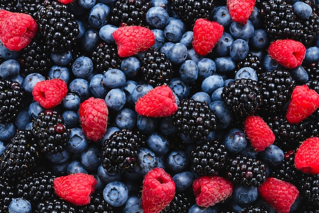 Blackberry, raspberry, blueberry background.  top view.