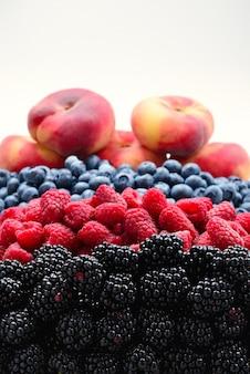 Blackberry, raspberry, blueberry, fig peach background.