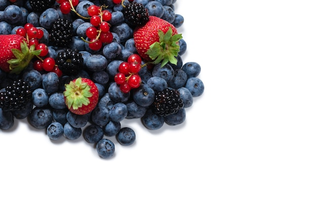 Blackberry, raspberry, blueberry,  red currant isolated on a white background. top view.