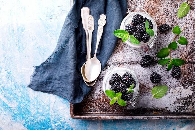 Blackberry with greek yogurt. summer  sweet dessert.
