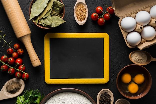 Blackboard amidst cooking ingredients