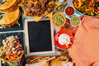 Blackboard amidst Mexican dishes and tablecloth