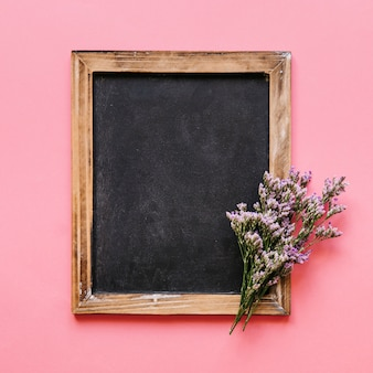 Blackboard and colorful flower