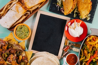 Blackboard and Mexican dishes composition
