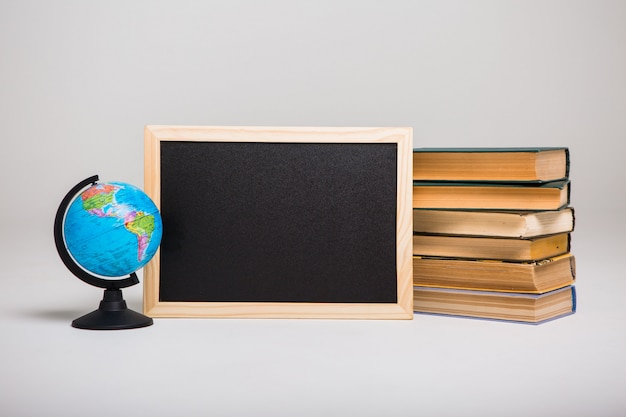 Blackboard, books and world globe