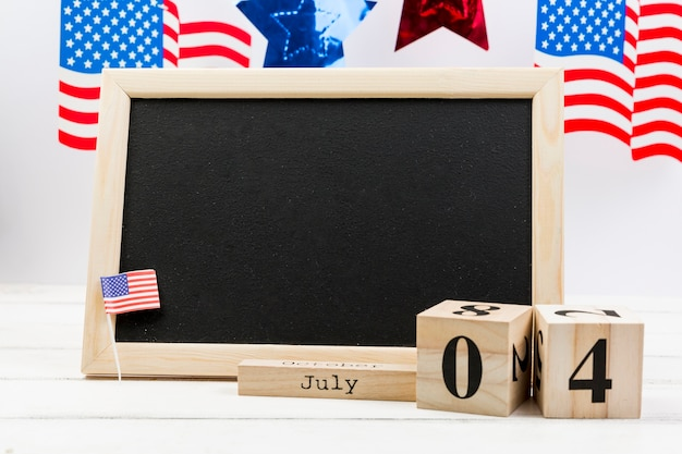 Blackboard decorated with small usa flag on independence day