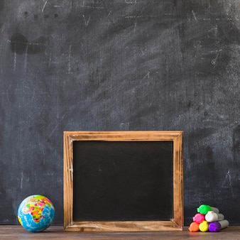 Blackboard frame with glove and markers