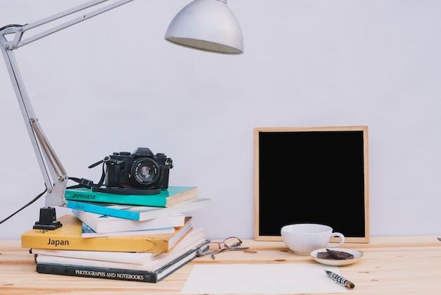 Blackboard near camera and books