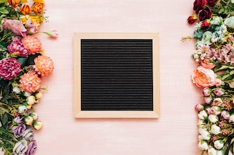 Blackboard on pink wooden background