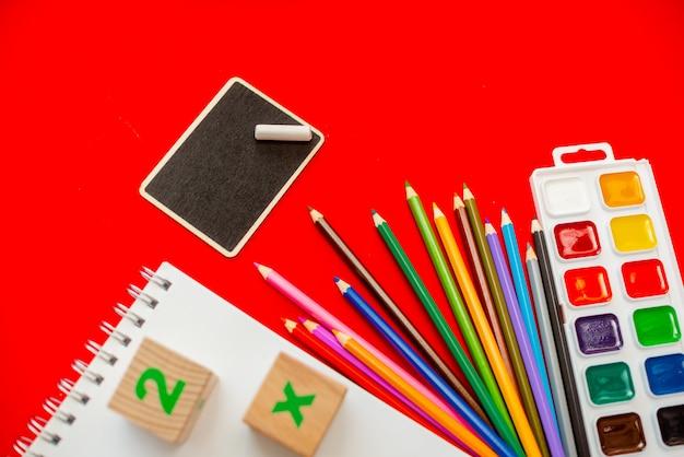 Blackboard pencils notepad numbs a b c alphabet waterolors.