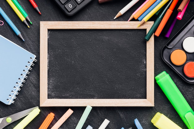 Blackboard slate with colourful stationery
