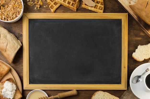Blackboard surrounded by breakfast