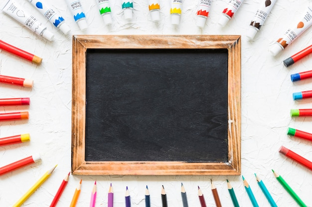 Blackboard surrounded by painting material