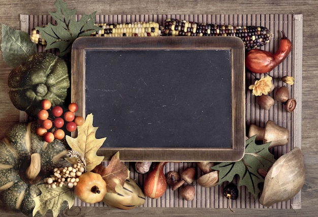 Blackboard with autumn decorations, space