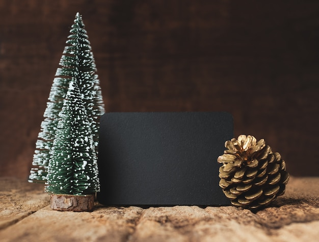 Blackboard with christmas tree and gold pine cone