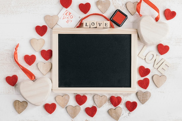 Blackboard with different types of hearts