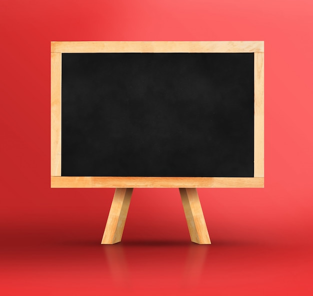 Blackboard with easel on vivid red studio backdrop
