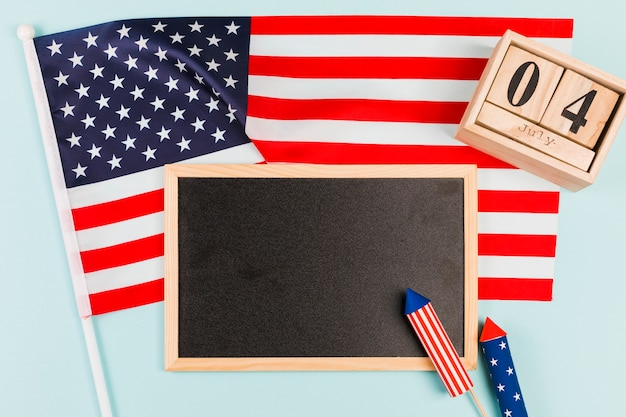Blackboard with flag and firecrackers