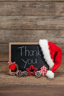Blackboard with a hat santa claus