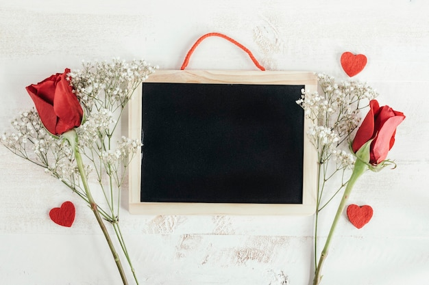 Blackboard with heart and red roses