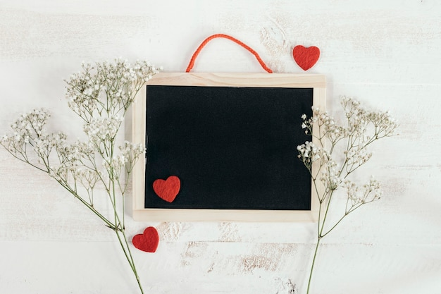 Blackboard with hearts and flowers