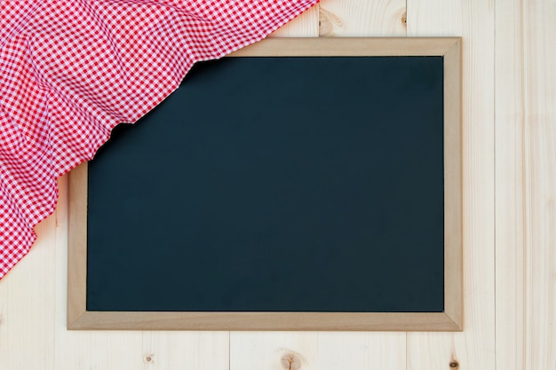 Blackboard with red checked cloth