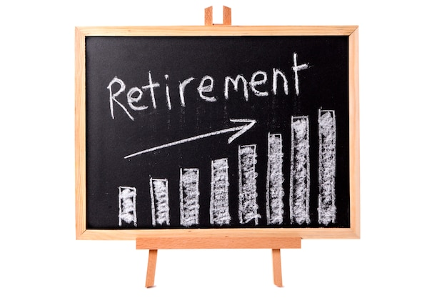 Blackboard with retirement savings chart.
