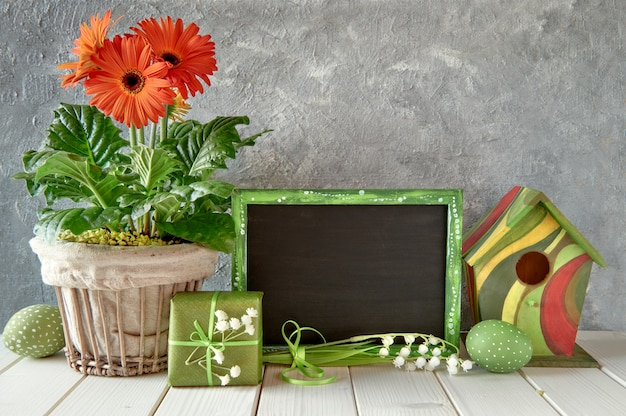 Blackboard with spring decorations