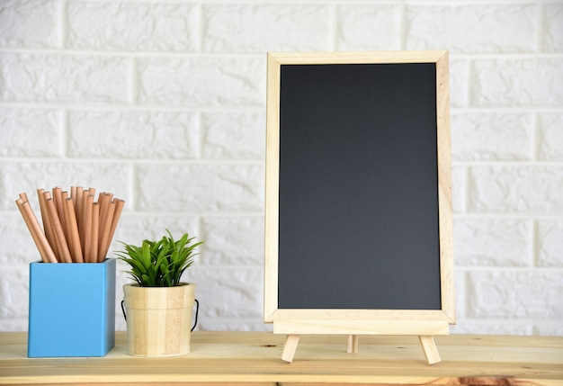 Blackboard on the wood table,with space for your text.