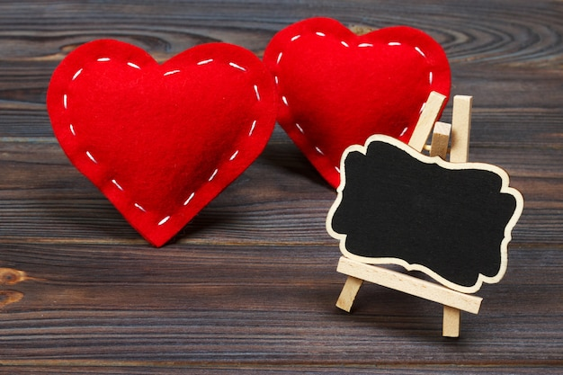Blackboard on wooden background with red heart. copy space