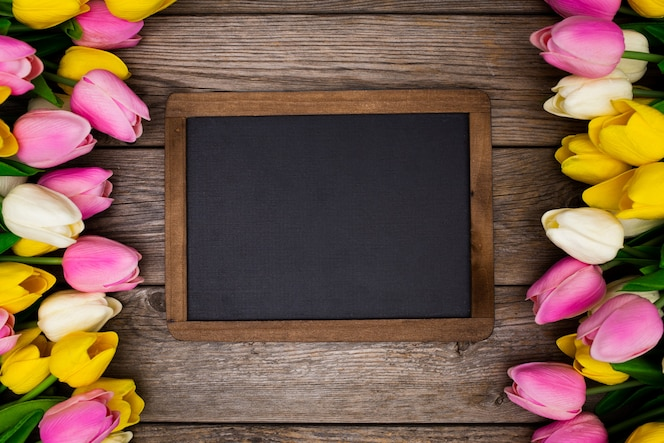 Blackboard on wooden with tulips