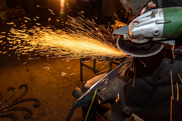 Blacksmith, knife sharpening, sparks, metal.