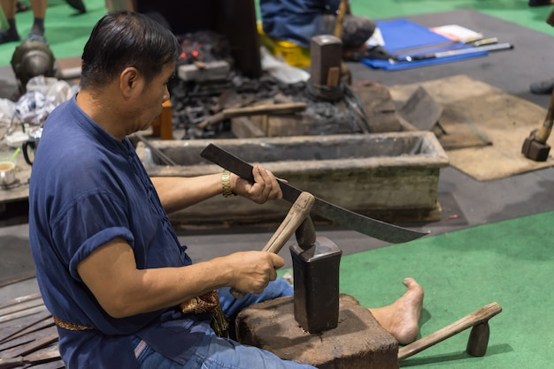 Blacksmith, professional knife hit knife or sword
