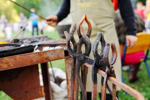 Blacksmith's tools against the backdrop of fire