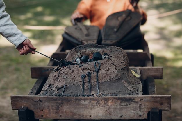 Blacksmith at work and tool