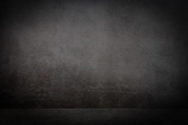 검은색 질감의 바닥과 회색 질감의 금이 간 벽