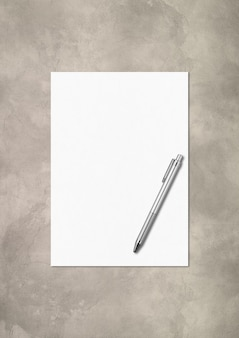 Blank a4 paper sheet and pen mockup template isolated on concrete background
